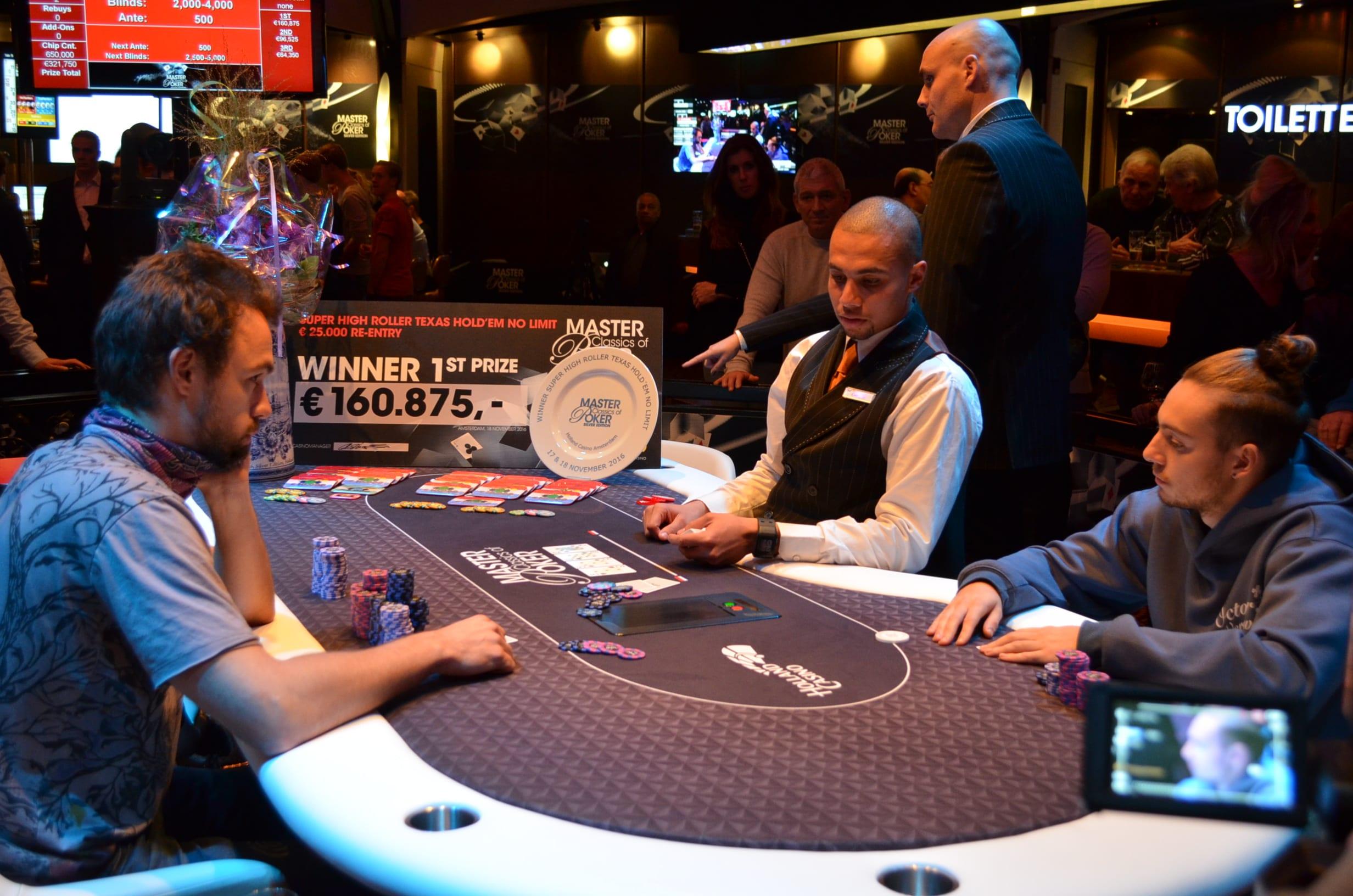 http://www.pokercity.nl/uploads/lrFoto/event1381/DSC_0385.JPG